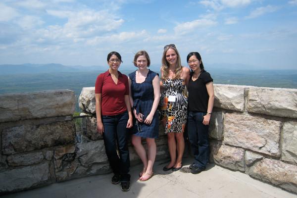 [from left] Students Elizabeth Wasmuth, Karen Hunter, Ellen Hukkelhoven, and Isabel Lam enjoy the view during a break from the retreat's formal program.