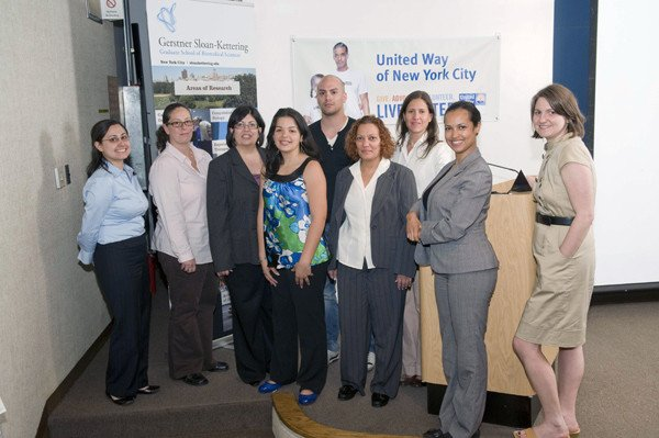 Program supporters included Gerstner Sloan Kettering PhD student Eric Alonzo (center) and Associate Dean C. Gita Bosch (center, gray suit and white blouse), as well as staff from Focus Forward, United Way of New York City, and the New York City Board of Education.