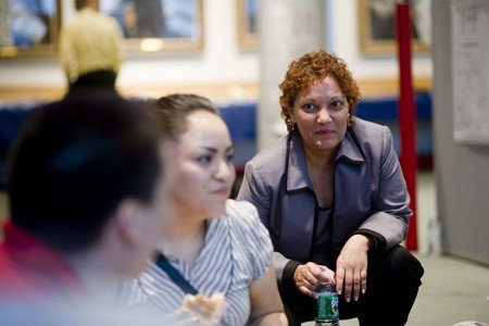 Associate Dean Gita Bosch (right) listens in on students' comments about the day.