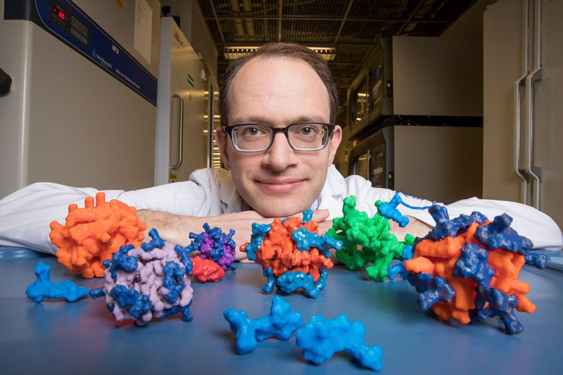 MSK chemist Daniel Heller with models of his nanoparticles