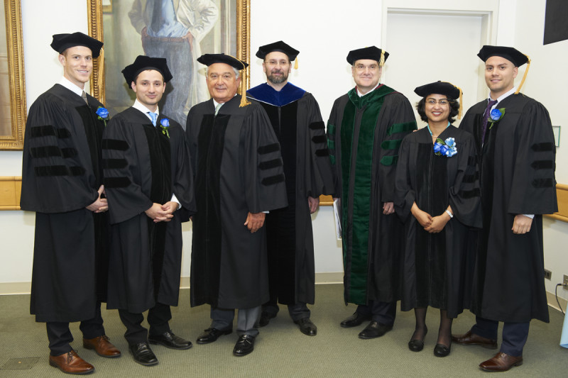 Pictured: Louis Gerstner, Kenneth Marians, Craig Thompson, James Dowdle, Dimiter Tassev, Semanti Mukhurjee, and Eric Alonzo