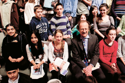 Students pose with Memorial Sloan Kettering President Harold Varmus after the symposium.