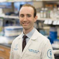 S Millman, MD PhD