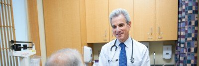 A doctor speaks with a patient who has advanced prostate cancer about inherited mutations.