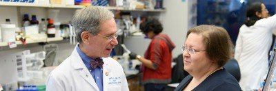 MSK clinical geneticist Kenneth Offit and genetic counselor Yelena Kemel pictured in a laboratory